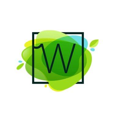 W letter logo in square frame at green watercolor splash backgro
