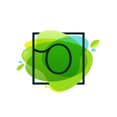 O letter logo in square frame at green watercolor splash backgro