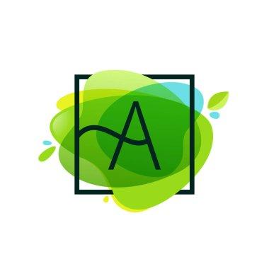 Letter A logo in square frame at green watercolor splash backgro