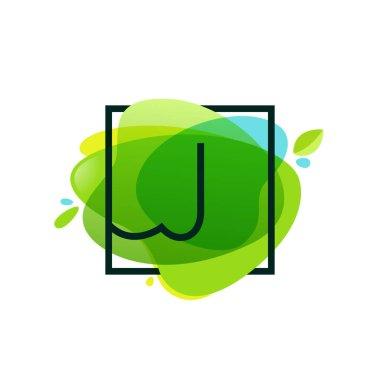 J letter logo in square frame at green watercolor splash backgro