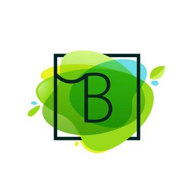 B letter logo in square frame at green watercolor splash backgro