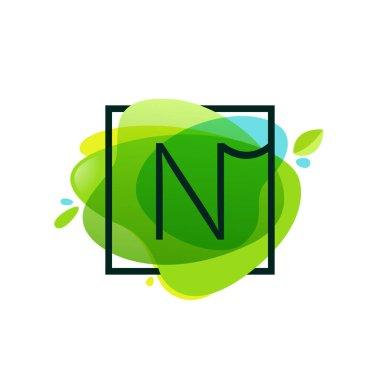 N letter logo in square frame at green watercolor splash backgro