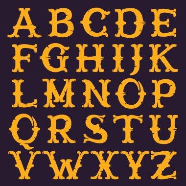 Vintage decorative serif alphabet with rough edges.