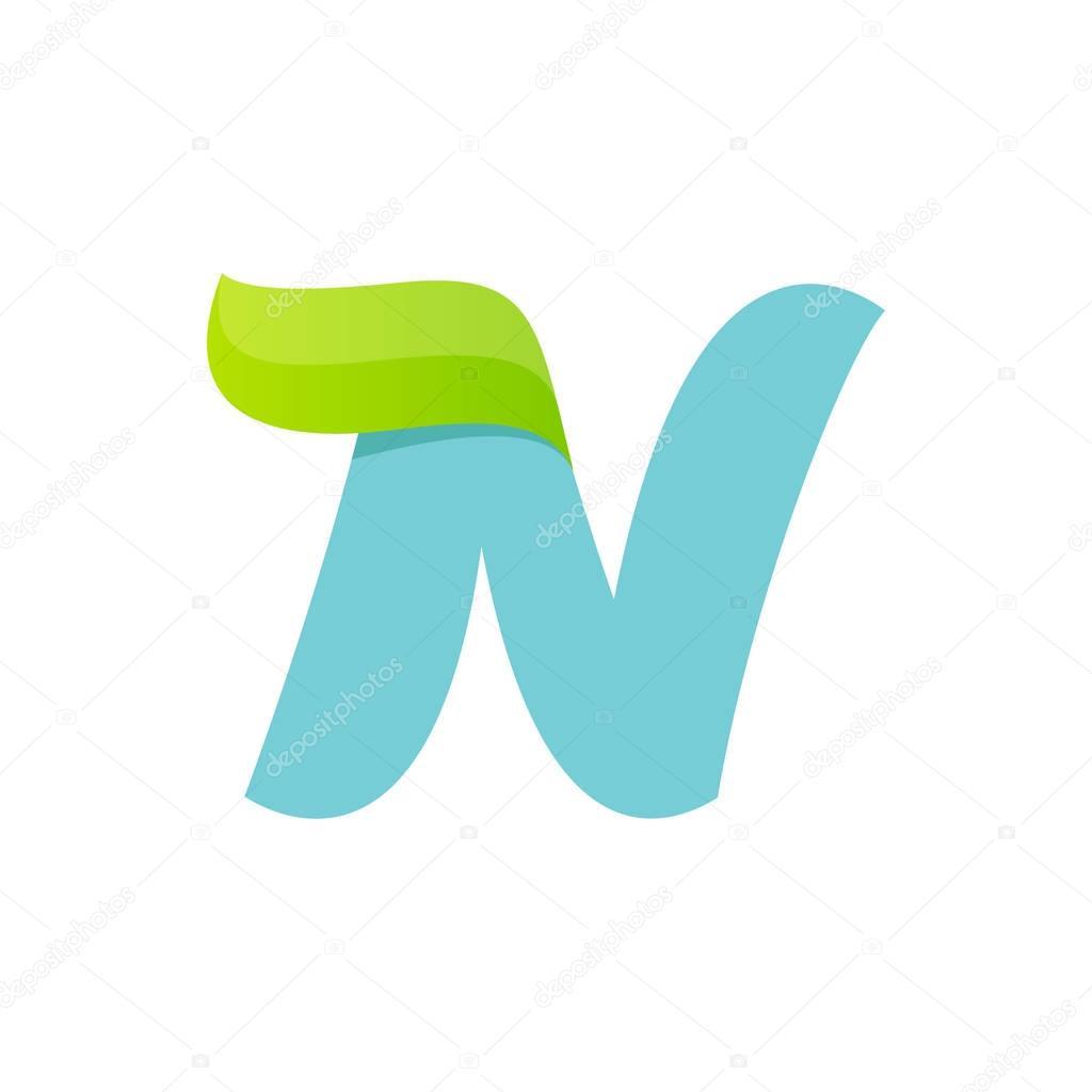 N letter logo with green leaf.