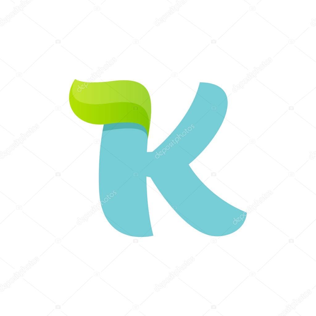 K letter logo with green leaf.