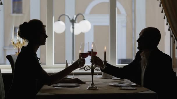 Couple Toasting Wine Glass in Restaurant.