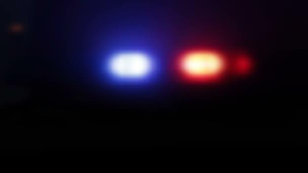 Policie nouzových světel v noci ve městě