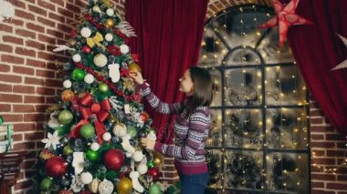 woman decorating christmas tree home christmas period - Videos Of Decorated Christmas Trees