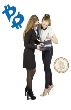 Beautiful women standing over white background with bitcoin sketches and talking. Virtual money concept. Cryptocurrency