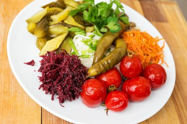 a plate with pickles