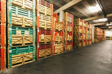 warehouse with boxes of wine