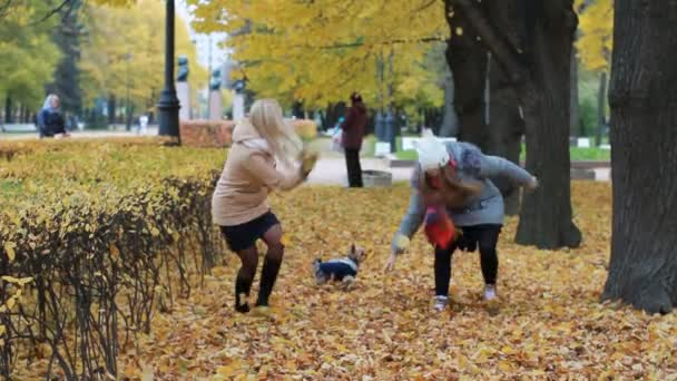 Family holiday in nature - a young woman and her teenage daughter are resting in the autumn park, running and having fun.