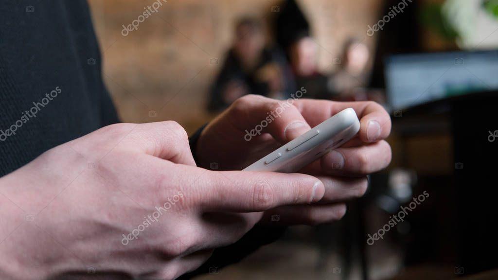smartphone in men's hands  close-up.