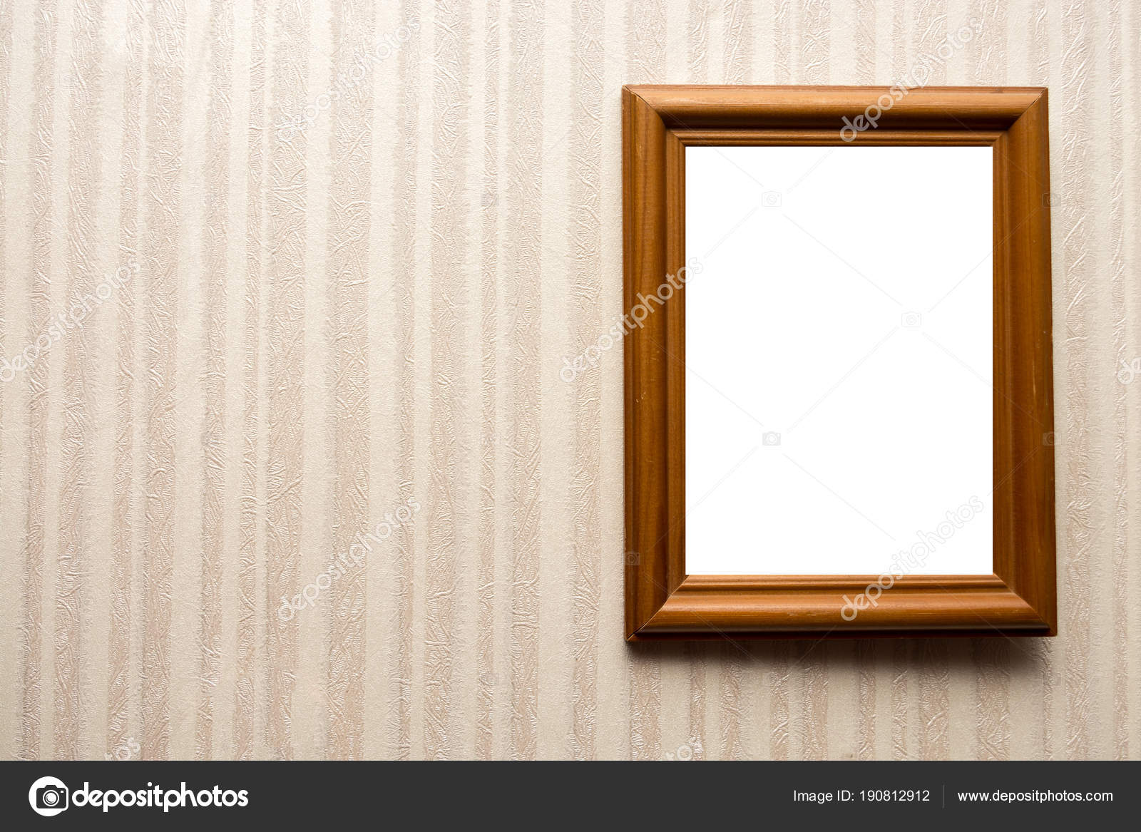 Wooden empty frame on wall with wallpaper in stripes. For your text ...