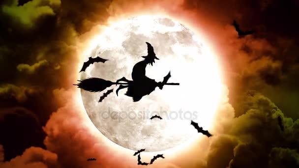 Halloween netopýři a čarodějky v rudá obloha a mraky