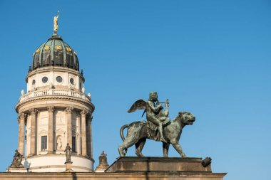 Statue and french dome at Gendarmenmarkt, historic Berlin