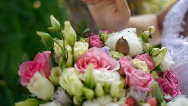 Bride holding wedding bouquet in hands