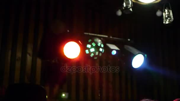 Moving multicolor projector spot lights on stage. night club the view for dancing