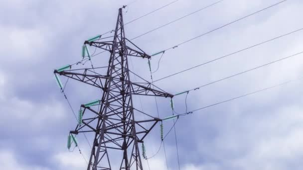 High-voltage tower of power lines. Risk of electric shock. Renewable electricity. Production and transportation of electricity by wire for longer distances. Electric power industry.