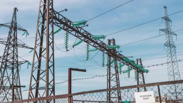 Electric high-voltage substation. Renewable clean energy. Electric generators and wires on the support. Energy industry. Power generation and transportation