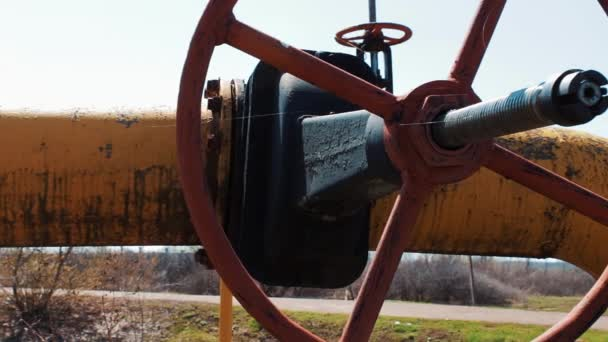 Oil and gas shut-off valve close-up. Pipeline of oil materials and natural gas. Production and processing of gasoline and other fuels. Storage station