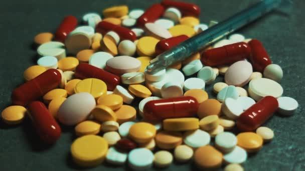 Pharmaceutical industry. Making tablets, pills and other medications. Multi-colored tablets with a syringe and an injection needle. Prescription for a doctor. Purchase of drugs in the pharmacy. Drugs