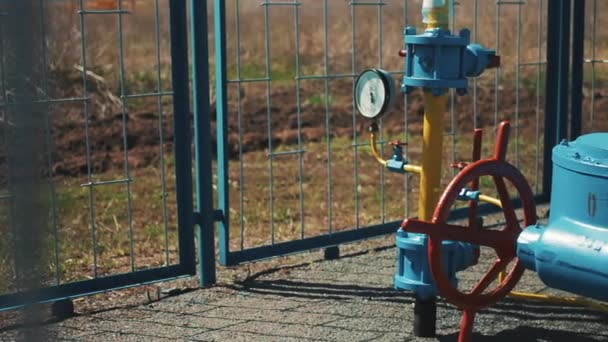 Gas pipe with manometer. Large red shut-off valve. Supply of natural gas to the public. Station for pumping and transportation of gas. Cleaning and storage. Oil and gas industry.