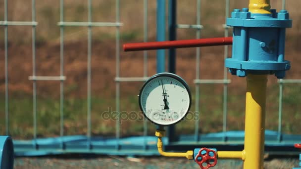 Gas pipeline with a manometer. A plant for cleaning, storing and transporting oil and gas. Yellow pipes. pumping station. Gas under pressure. Check valves