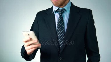 Stylish, elegant man in a suit is holding a phone in his hands. businessman