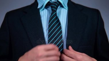 Slow motion, businessman in the office pulls the phone out of his jacket pocket