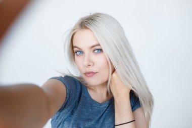 cute young woman making selfie photo