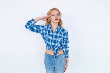 Confident woman in casual clothes saluting