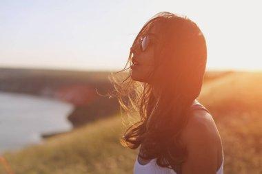 girl enjoying wind