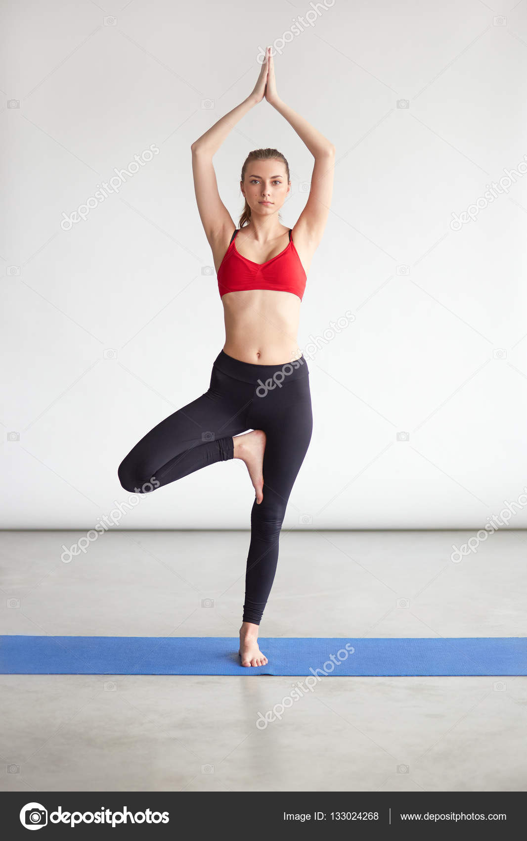 Fit Young Woman Practicing Yoga Exercise Called Tree Pose Girl Standing On One Leg Improving Balance And Concentration Photo By Kegfire