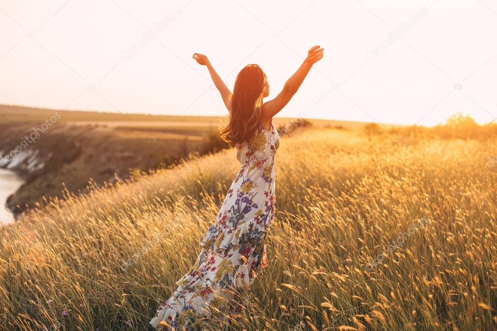 Back view of free Happy Woman Enjoying Nature.