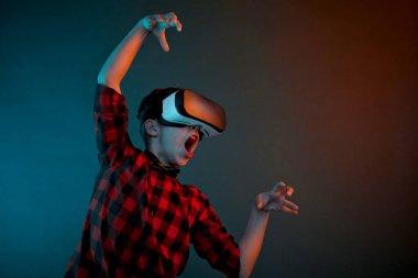 boy in VR headset gesturing