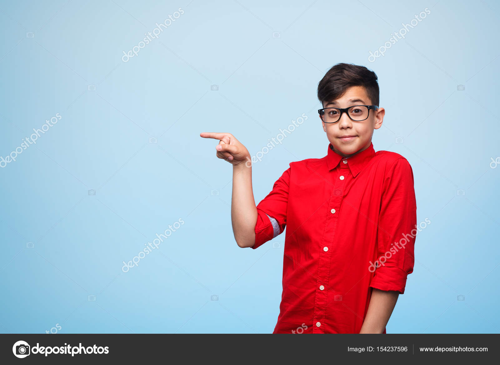 Young teen in glasses pointing — Stock Photo