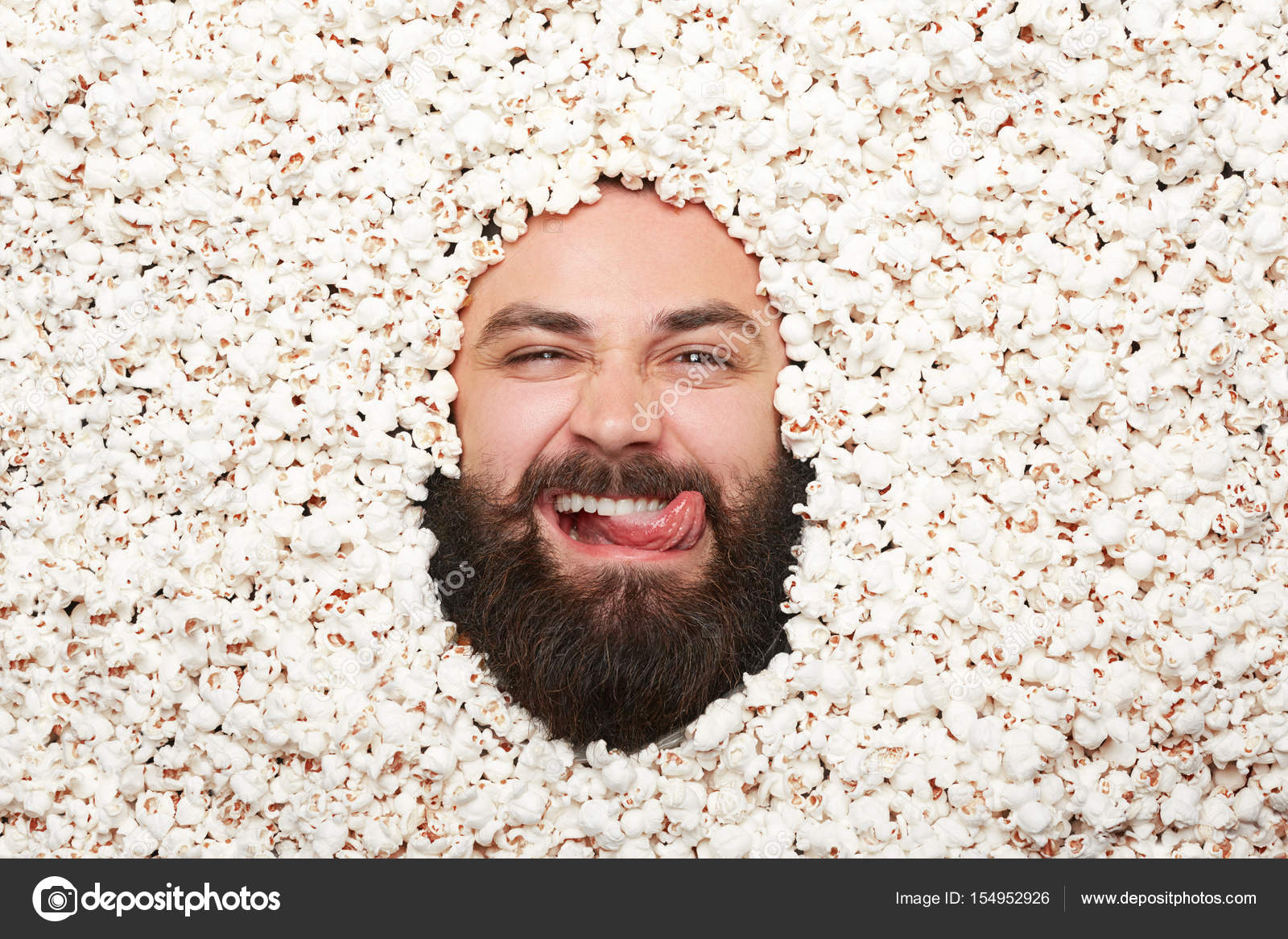 man in popcorn looking at camera stock photo kegfire 154952926
