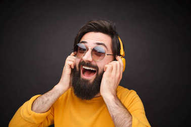 Excited man listening to music with headphones