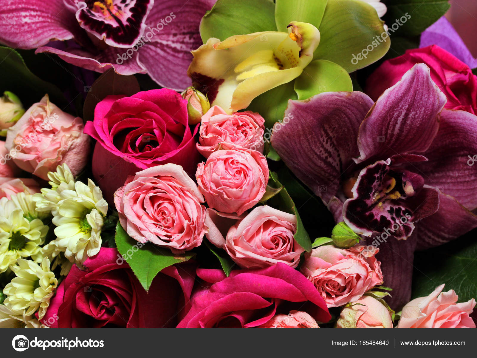 Beautiful spring bouquet of flowers close up on a pink background beautiful spring bouquet of flowers close up on a pink background bouquet of roses chrysanthemums lilies photo by oly214yandex izmirmasajfo