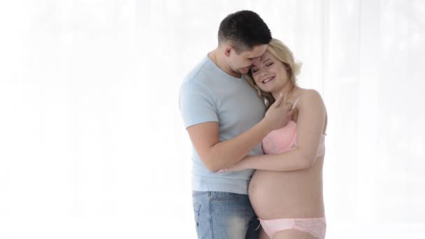 pregnant woman with her husband. Future parents, tenderness