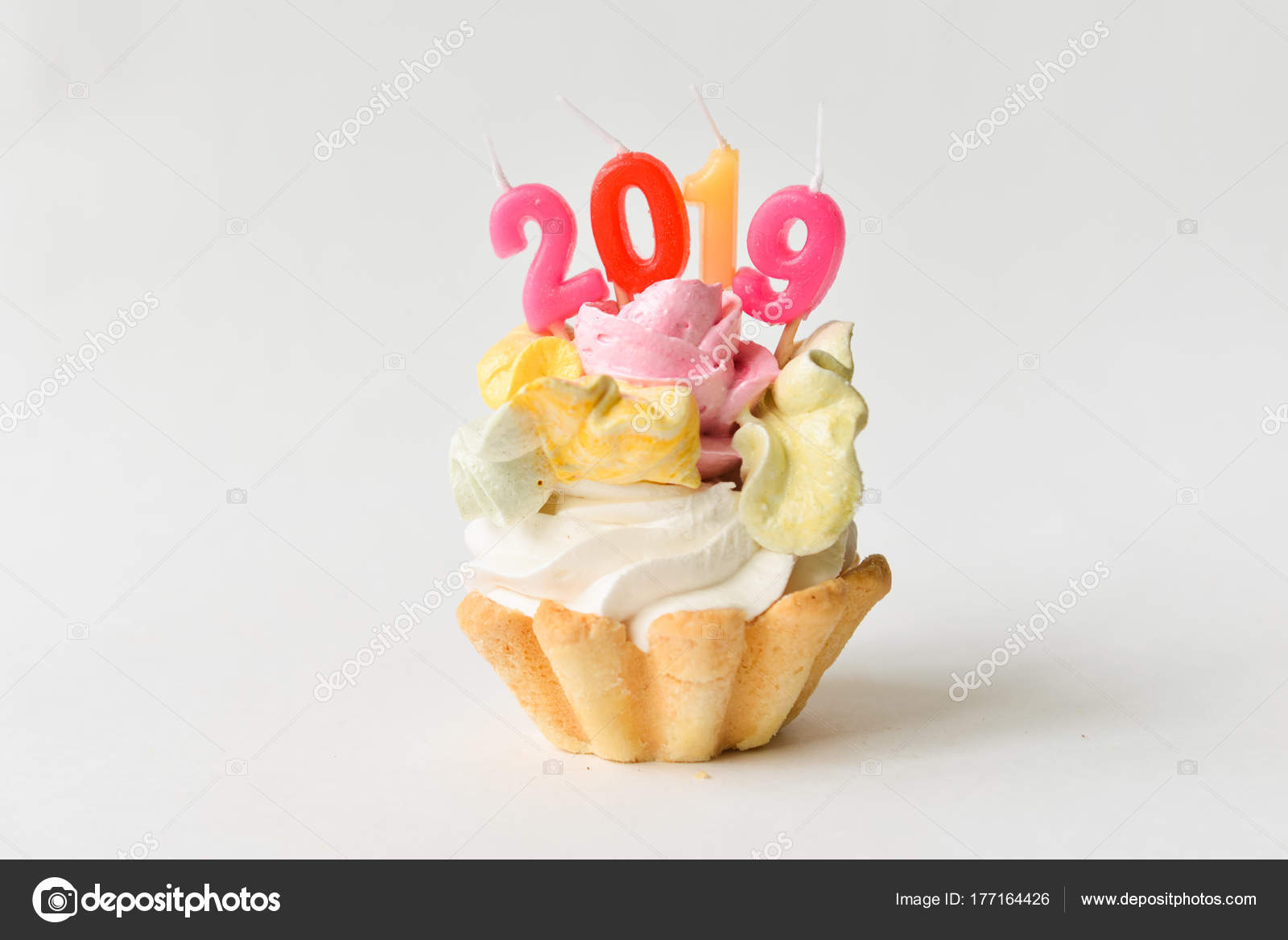 2018 happy new year cupcakes sweet cake with figures 2018 new year decor isolated on white background photo by olgachan