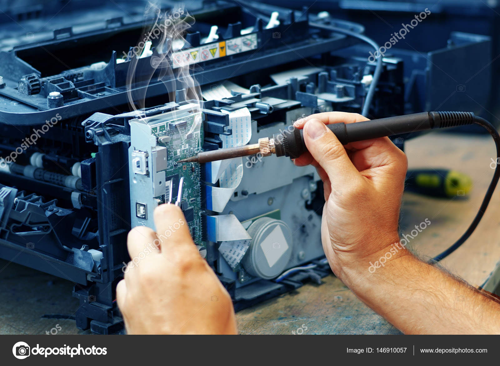repair computer motherboard with soldering iron close up stock photo elit76 146910057. Black Bedroom Furniture Sets. Home Design Ideas