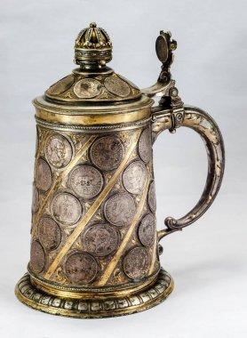 Old German beer mug with coins