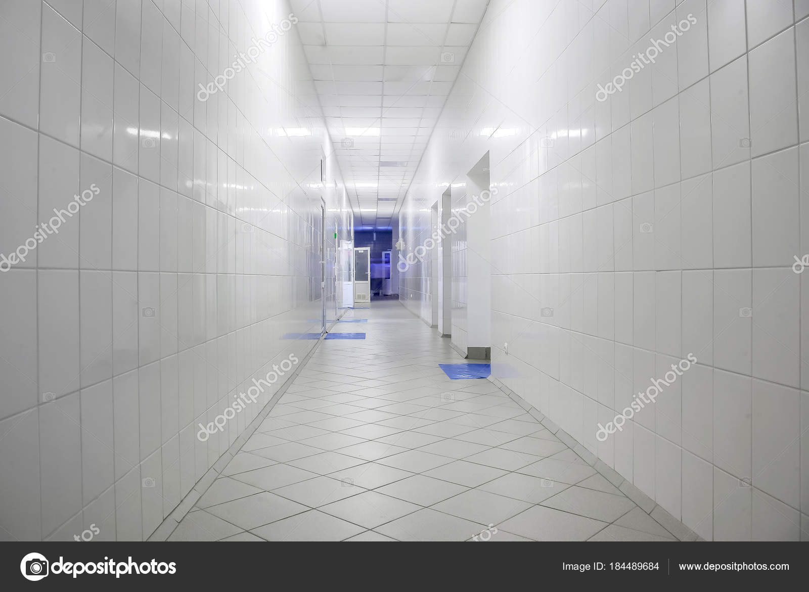 Long corridor with white tiles in industrial factory — Stock Photo ...