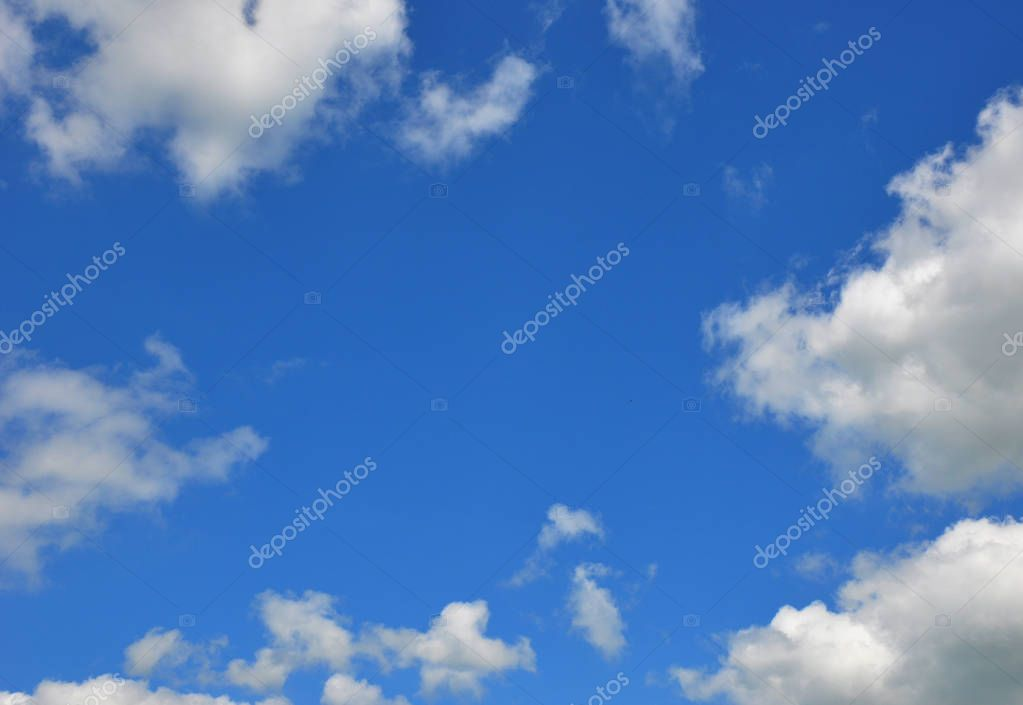 Blue clouds sky with blue background and copy space.