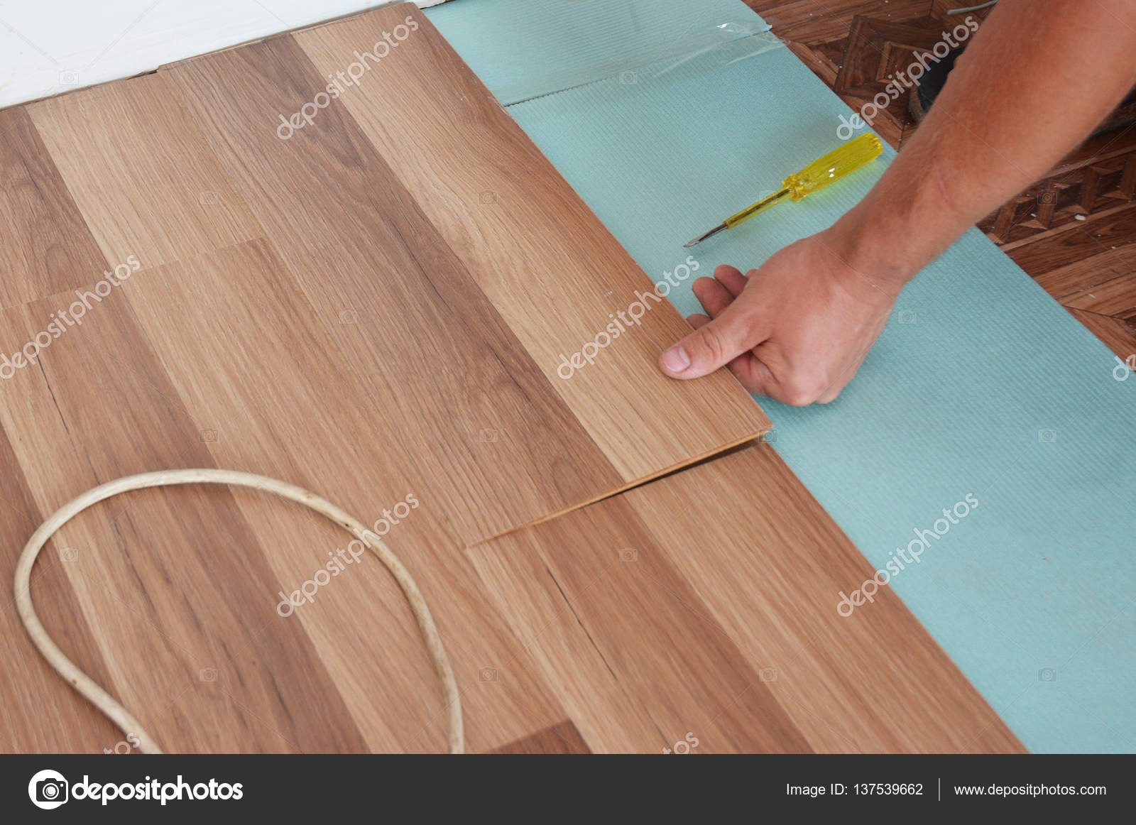 Man Installing New Laminate Wood Flooring Wooden Step By