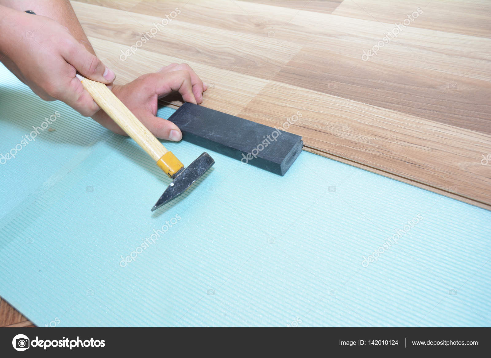 Worker Installing Wooden Laminate Flooring With Hammer Handyman Laying Down Boards While Renovating A House Photo By Thefutureis