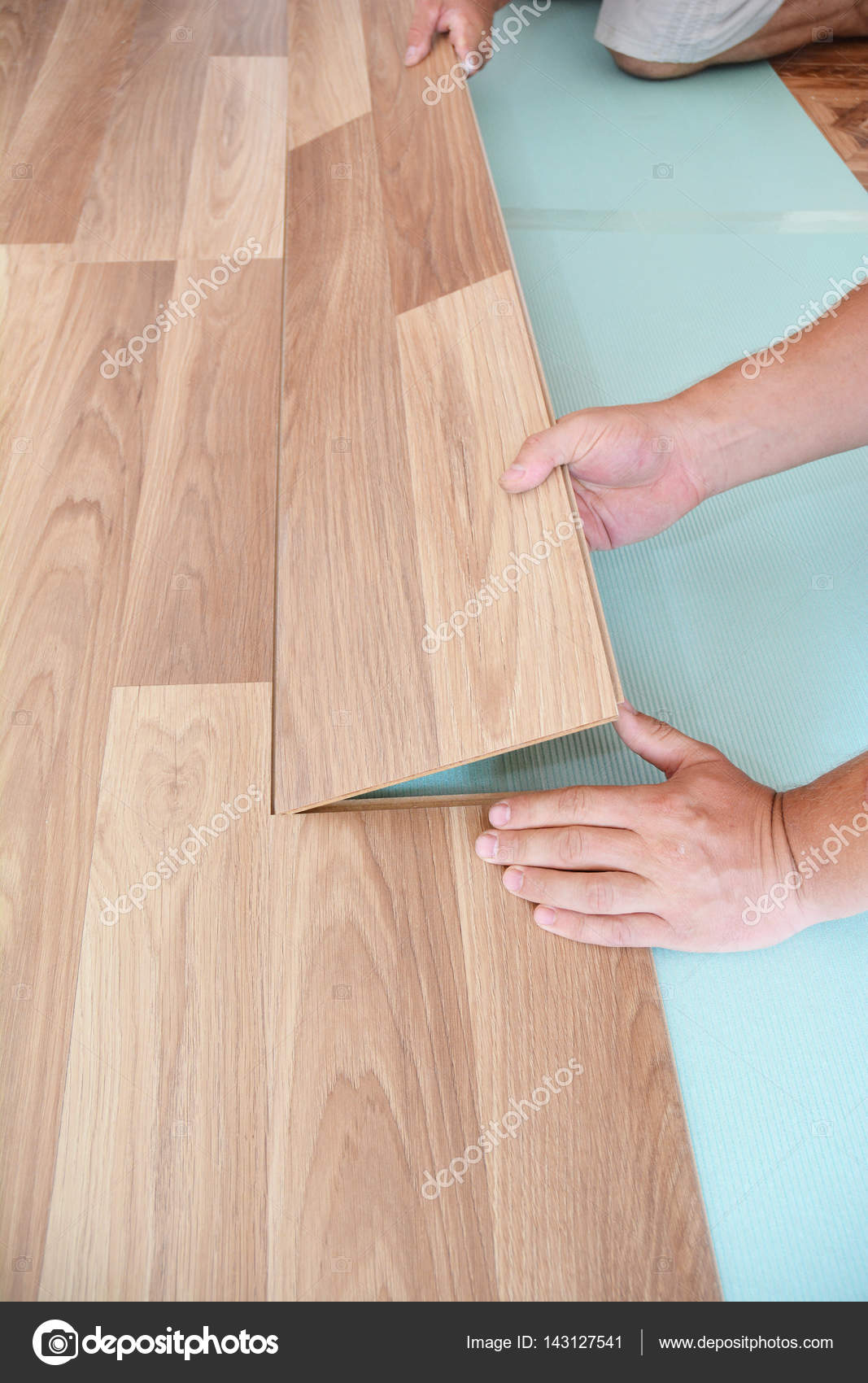 Contractor Installing Wooden Laminate Flooring With