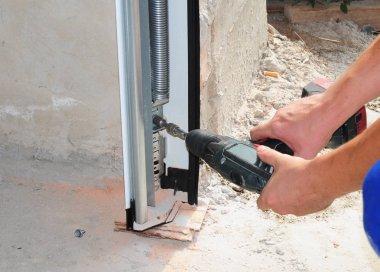 Constructor installing and Repair Garage Door. Repair, Insulating Garage Door. Garage door seal, garage door springs, garage door replacement, garage door repair.
